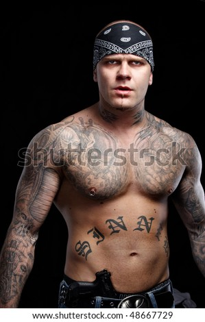 stock photo : Tattooed gangster with gun