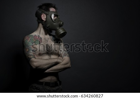 Stock Photo tattooed man with gas mask