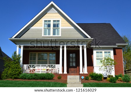 Taupe, Yellow, and Brick Cape Cod American Home with Front Porch