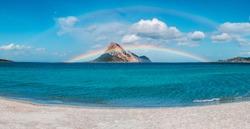 Tavolara island in front of the Sardina beach, amazing water condition rain and sun together for this amazing rainbow