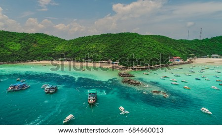 Tawaen and Tong Lang beach aerial. Koh Larn island and his tropical beaches. Beautiful Thailand seaside landscape.Crystal clear water beach with speed boats anchored. Pattaya city, Thailand.