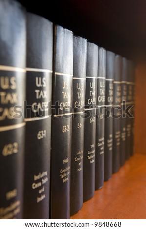 Tax books on bookshelf - stock photo