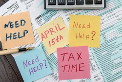 Tax concept sticker need help with calculator on federal tax form. Business accounting