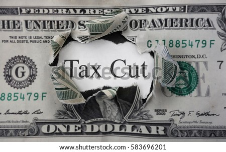 Tax Cut text on a scrap of paper within a torn dollar bill                                #583696201