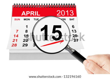 Tax Day Concept. 15 april 2013 calendar with magnifier on a white background
