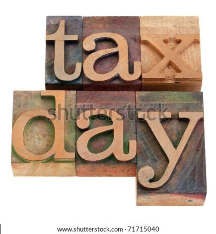 tax day - words in vintage wooden letterpress printing blocks, stained by color inks, isolated on white