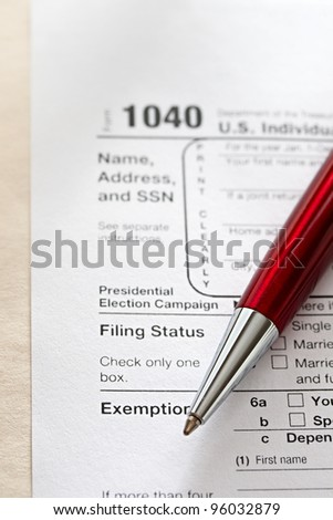 Tax form and a red pen
