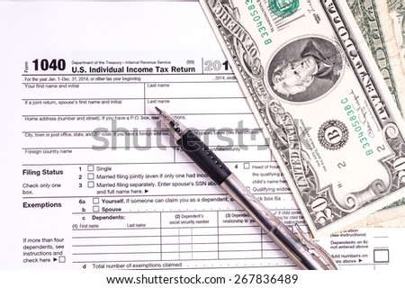 Tax form and Money. Filling the forms and hoping for a tax refund return