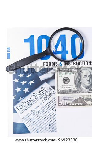Tax form booklet 1040 with magnifying glass and money on white background