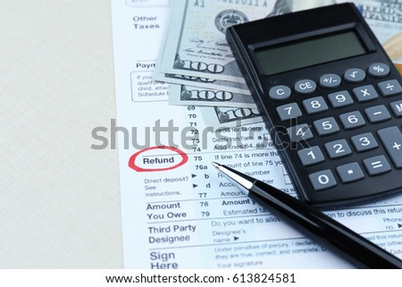 tax form calculator and dollars on table ez canvas