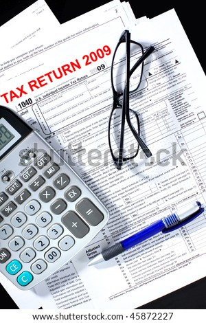 Tax form, calculator, pen on the table