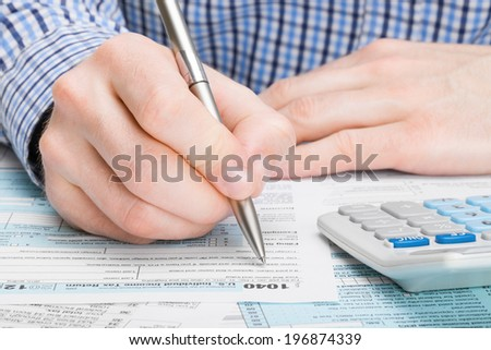 Tax Form 1040 - male filling out tax form