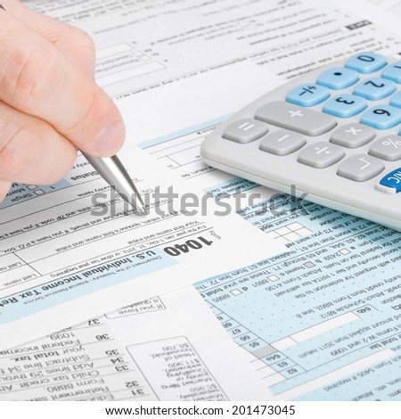 Tax Form 1040 - man filling out tax form - 1 to 1 ratio