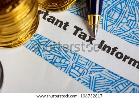 Tax form with coins and pen