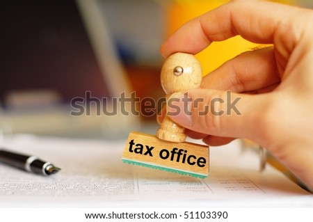tax office concept with stamp and copyspace