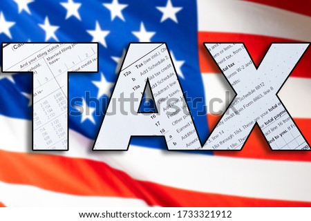 TAX. Paying taxes in the USA. Internal Revenue Service. Concept - IRS USA. Concept - services of a tax attorney in America. Flag of the United States of America. Inscription tax. Taxation