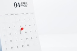 Tax payment day April 15 2020 marked a calendar on white background, copy space for text