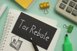 Tax rebate is shown on a business photo using the text