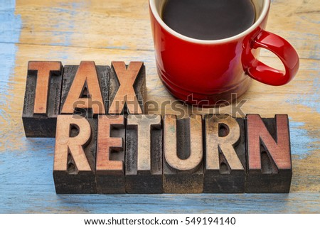 tax return - word abstract in vintage letterpress printing blocks with a cup of coffee