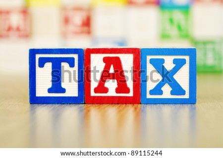 TAX Spelled Out in Alphabet Building Blocks
