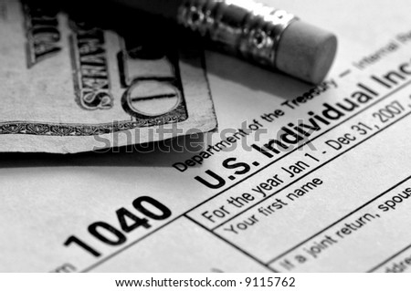 stock-photo-tax-time-a-pencil-us-ten-dollar-bill-and-federal-tax-form
