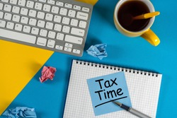 Tax Time - accauntant or businessman workplace with notification of the need to file tax returns, tax form