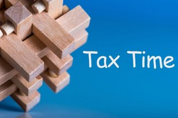 Tax Time - brean teaser or puzzle with notification of the need to file tax returns, tax form