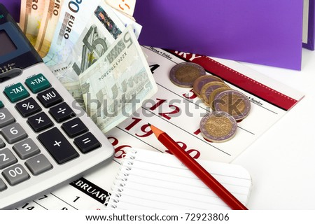 Tax time concept. Calculator and euro bill close up
