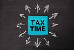 Tax Time concept on the sticky note paper.