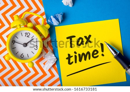 Tax time -15th April 15 - Tax day in USA. Notification of the need to file tax returns, tax form at accauntant workplace