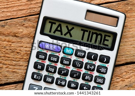 Tax Time word on calculator. Business concept. Time to pay tax in year.
