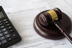 taxation law concept. judge gavel and money on individual income tax form.