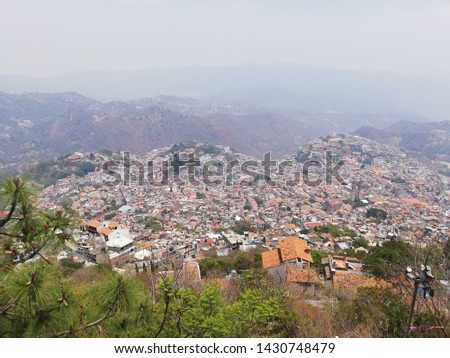 TAXCO, GUERRERO/MEXICO-APRIL 22RD 2019: A sunset falls in the small town,