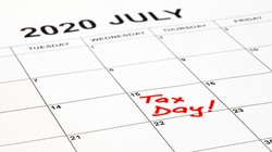 Taxes due date is set for 15th July 2020 due to corona virus outbreak. Calendar page with Tax Day written in red, remainder to pay taxes. Filling and payment was extended by the government.