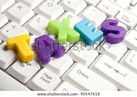 Taxes word made by colorful letters on keyboard
