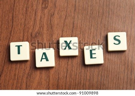 Taxes word made by letter pieces
