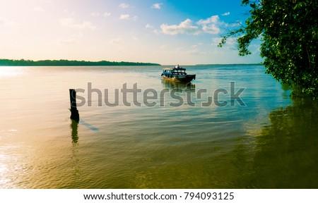 Taxi boat in Suriname #794093125