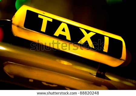 Taxi cab at night with the sign lit
