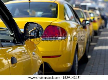 Taxi cabs lined up waiting for customers