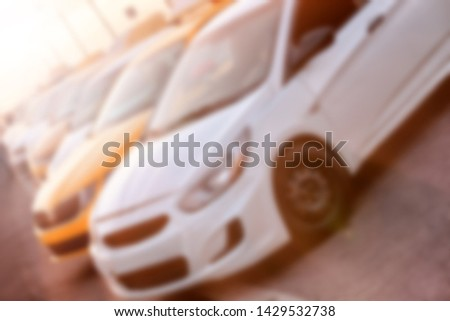 taxi car on parking waiting for passenger on sunset blur background street view of modern city yellow and white cab parked in line public town transportation abstract off level blurred concept #1429532738