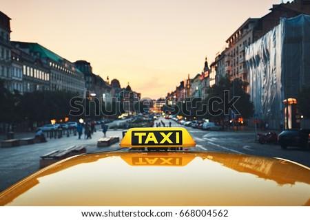 Taxi car on the city street at dusk.  Wenceslas Square, Prague, Czech Republic