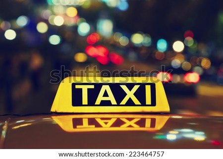 Taxi car on the street at night
