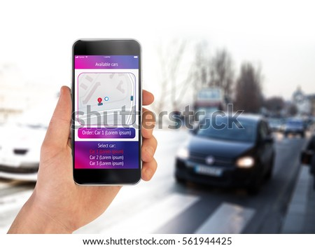 Taxi car order app for smartphone concept. Hand holding smartphone with displayed app #561944425