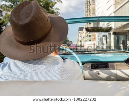 Taxi driver in a classic american car in Havana, Cuba