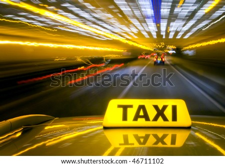 Taxi driving at high speed through the heavy traffic at night, seen from the roof of the cab