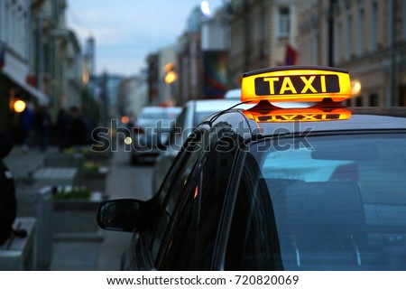 Taxi in the evening on the street
