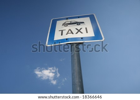 taxi sign against blue sky