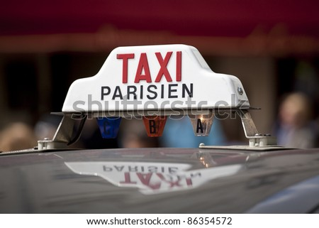 Taxi sign on a cab in Montmartre, Paris