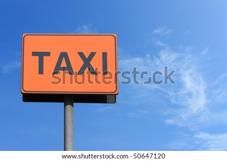 taxi sign over blue sky