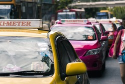 Taxi waiting for passengers in front of Chatuchak market in Bangkok, Thailand